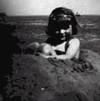 Barbara at the beach at the age of three