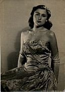 Barbara, aged 16, in a strapless, pale blue brocade evening gown