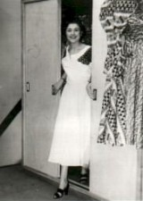 Barbara at eighteen popping out of the fashion dept. 'dress' cupboard at the Yorkshire Evening Post