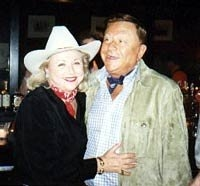 Barbara Taylor Bradford dons a cowboy while visiting a Texas watering hole with husband, Bob Bradford
