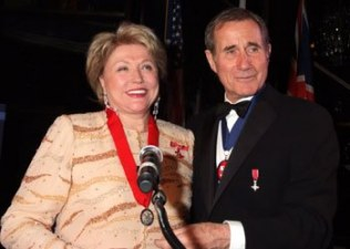 English screen/stage actor Jim Dale presents Barbara with her medal
