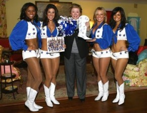 Barbara Taylor Bradford is presented with an autographed boot from the Dallas Cowboys Cheerleader squad at the Lupton Ranch in Dallas, Texas