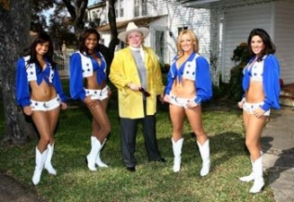 Barbara Taylor Bradford and the Dallas Cowboys Cheerleaders outside the Lupton family home in Dallas, Texas