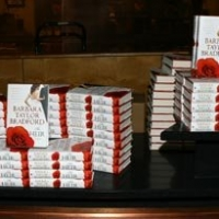 A stack of Barbara Taylor Bradford's novel, The Heir, awaits the guests of the gala event at the Dallas Women's Museum