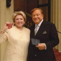 Barbara Taylor Bradford showing her OBE with Robert Bradford