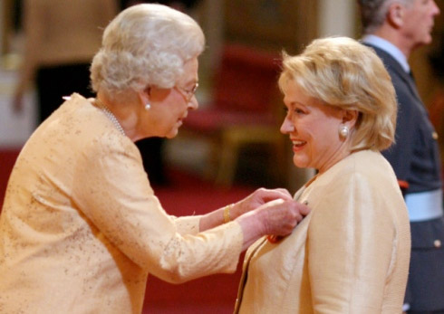 Barbara gets her OBE from Queen Elizabeth II
